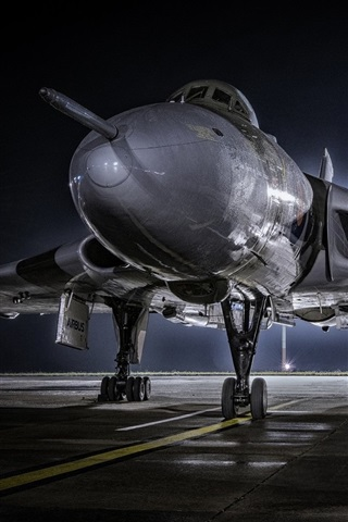 iPhone Wallpaper Combat aircraft front view, airport, night