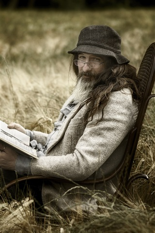 A Man Read Book Glasses Hat Grass Chair 1125x2436 Iphone