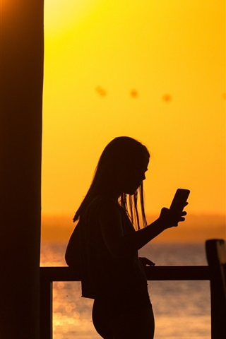iPhone Wallpaper Girl use phone, silhouette, sunset