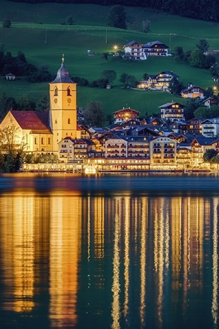 iPhone Wallpaper St. Wolfgang, Austria, city, night, houses, lights, river, water reflection