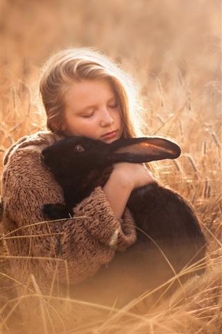 iPhone Wallpaper Cute girl and black rabbit, grass