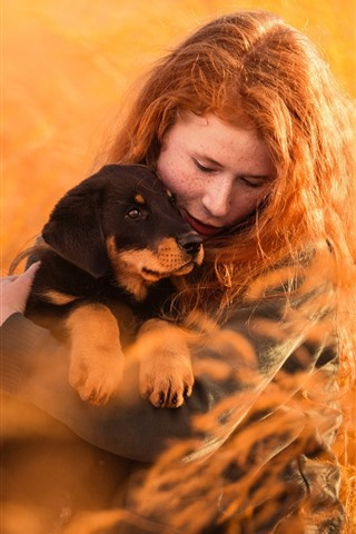 iPhone Wallpaper Red hair girl and dog, grass, nature