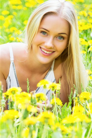 iPhone Wallpaper Smile blonde girl, yellow flowers, spring