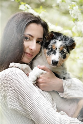iPhone Wallpaper Black hair girl and dog, flowers, hazy