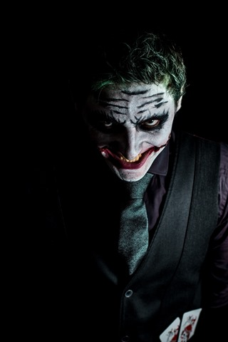Joker Black Background 1125x2436 Iphone 11 Pro Xs X Wallpaper Background Picture Image