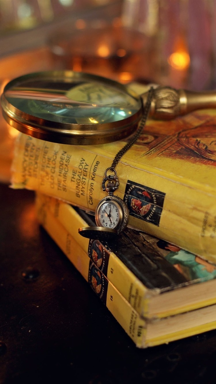 Books, magnifying glass, pocket watch, candles, still life ...