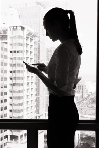 iPhone Wallpaper Girl use phone, window, black and white picture