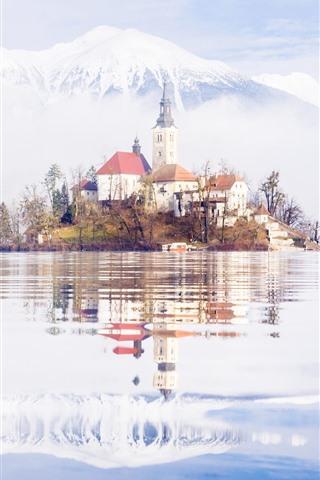 iPhone Wallpaper Slovenia, lake, island, church, mountains, snow, water reflection