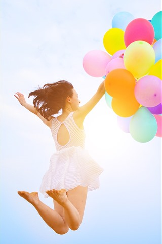 iPhone Wallpaper Girl jumping, colorful balloons, sky
