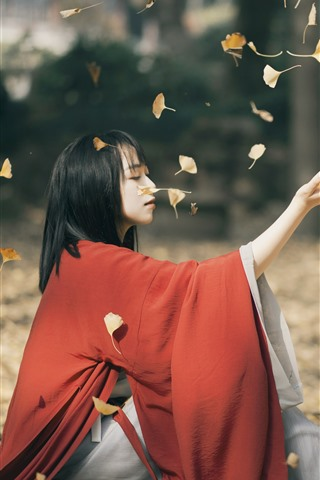 iPhone Wallpaper Red dress Asian girl, play yellow leaves