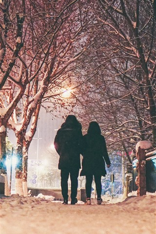 iPhone Wallpaper Winter, night, snow, trees, couple, rear view, lights, city