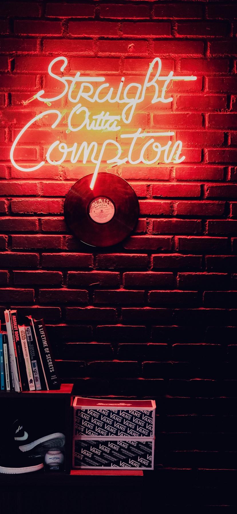 Books, vinyl record, wall, neon light ...