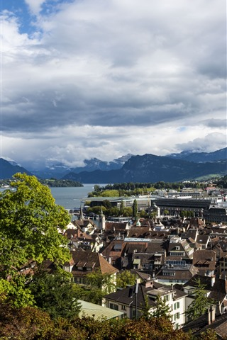 iPhone Wallpaper Switzerland, Lucerne, city, houses, river, mountains, clouds, trees