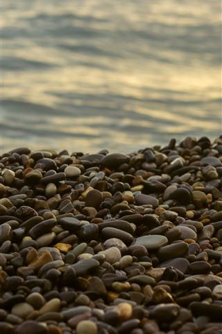 iPhone Wallpaper Many cobblestones, sea