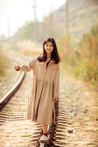iPhone Wallpaper Smile Asian girl walking on the railroad