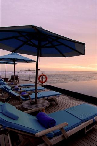 iPhone Wallpaper Resort, sea, palm trees, pool, lounge chair, sunset