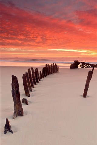 iPhone Wallpaper Sunset, sky, red clouds, beach, wood, sea