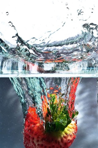 iPhone Wallpaper Two strawberries falling to the water, splash