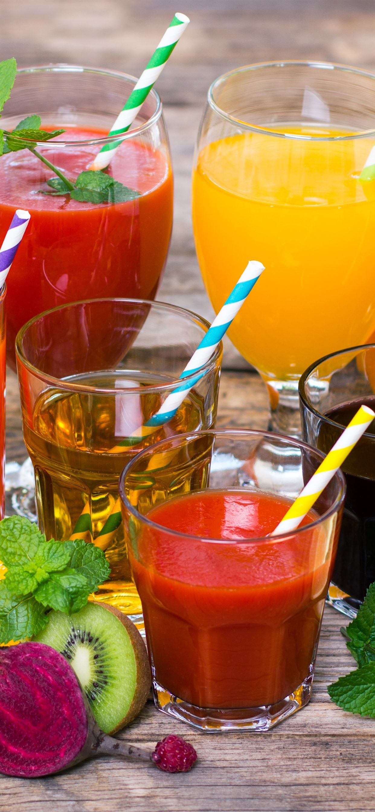 Different kinds of juice colorful cups