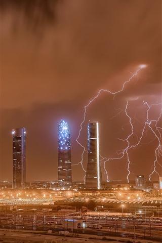 iPhone Wallpaper Madrid, city, skyscrapers, lightning, night