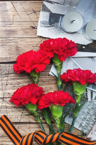 iPhone Wallpaper Red carnation flowers, candles, wood board