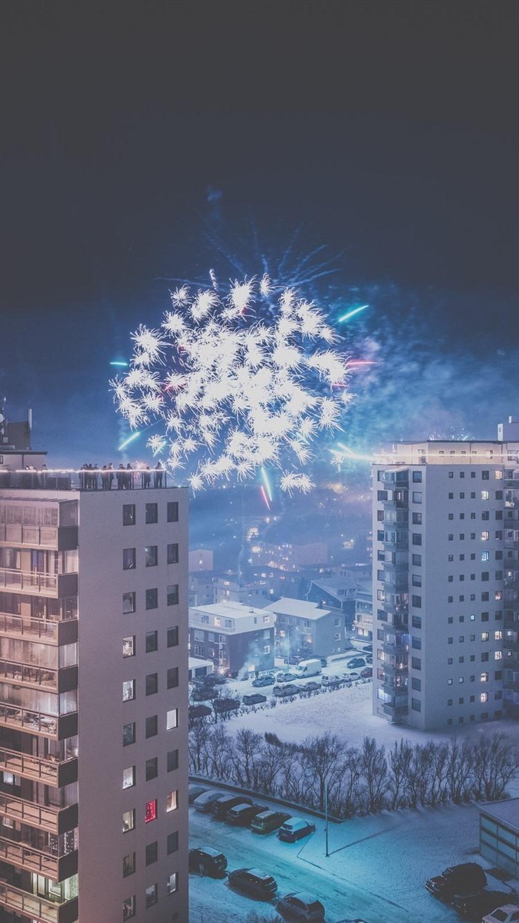 City Night Buildings Snow Fireworks Winter 750x1334