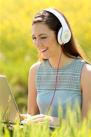 iPhone Wallpaper Happy girl use notebook, headphone, grass, summer