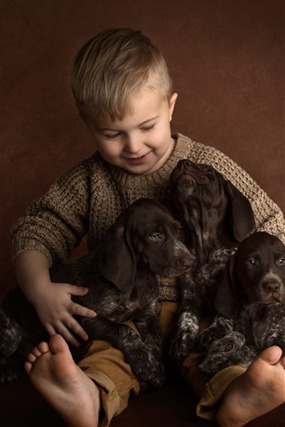 iPhone Wallpaper Little boy and three puppies