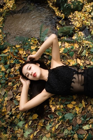 iPhone Wallpaper Black skirt girl, lying on ground, foliage