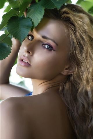 iPhone Wallpaper Blonde girl, look back, green leaves