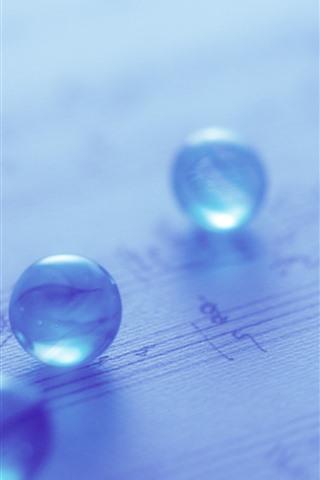 iPhone Papéis de Parede Algumas bolas de vidro, azul claro, nebuloso