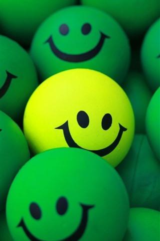 iPhone Papéis de Parede Algumas bolas verdes, carinha sorridente, uma amarela