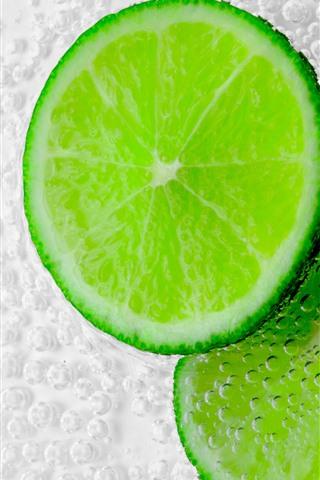 iPhone Wallpaper Green lemon slice, bubbles