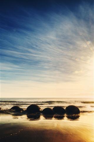iPhone Wallpaper New Zealand, sea, stones, sunrise, sky, glare