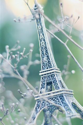 iPhone Wallpaper Eiffel Tower statue, toy, tree, twigs
