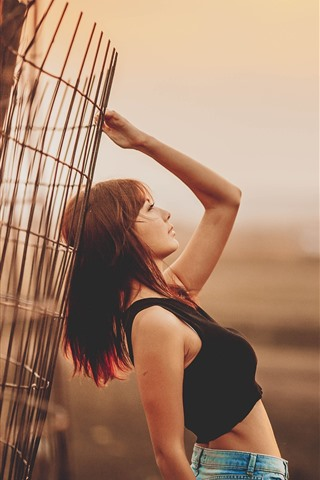 iPhone Wallpaper Asian girl, pose, fence, dusk