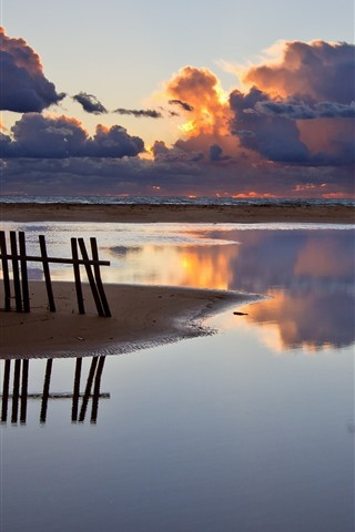 iPhone Wallpaper Fence, coast, sea, thick clouds, sunset