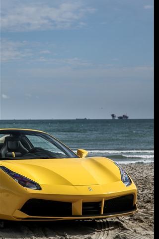 iPhone Обои Ferrari 488 желтый суперкар, море, пляж