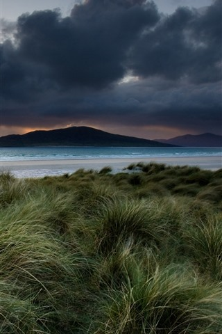 iPhone Wallpaper Mountains, sea, beach, grass, clouds, dusk