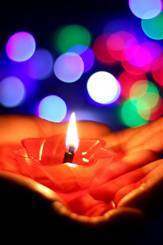 iPhone Wallpaper Hands, candle, flame, colorful light circles