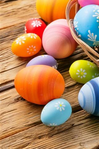 iPhone Papéis de Parede Ovos de Páscoa coloridos, cesta, mesa de madeira