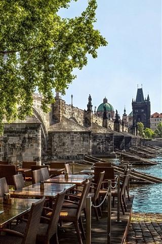 iPhone Wallpaper Prague, Czech Republic, cafe, tables, chairs, river, bridge