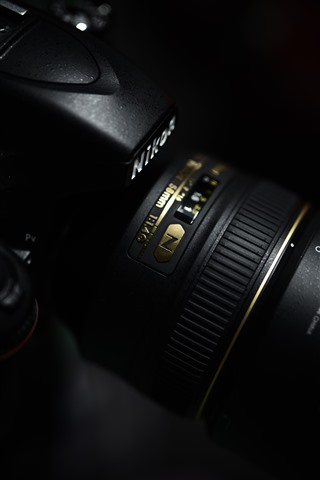 iPhone Обои Nikon Camera, объектив, черный фон