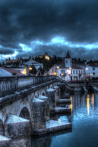 iPhone Wallpaper Portugal, Santarem, bridge, river, houses, lights, clouds, storm
